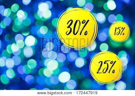 Blurred lights blue background. Sale discounts circles. Glittering christmas effect. Shimmering blur spots. Festive design.