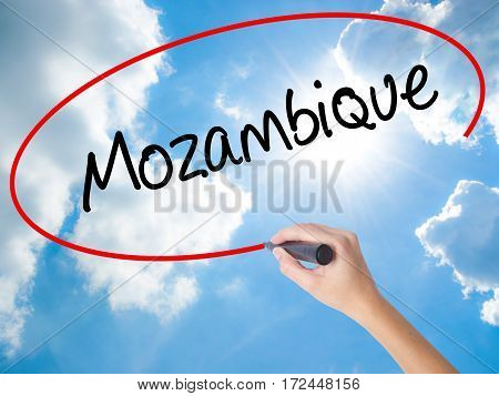Woman Hand Writing Mozambique  With Black Marker On Visual Screen