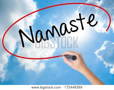 Woman Hand Writing Namaste With Black Marker On Visual Screen