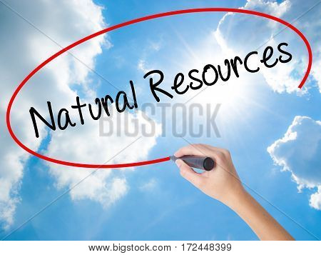 Woman Hand Writing Natural Resources With Black Marker On Visual Screen