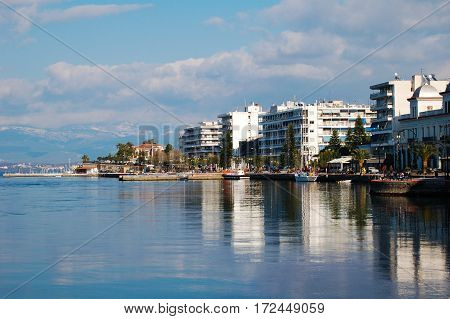 European waters in Greece, reflection with buildings over water