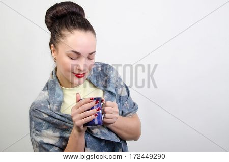 a young woman looks at a cup