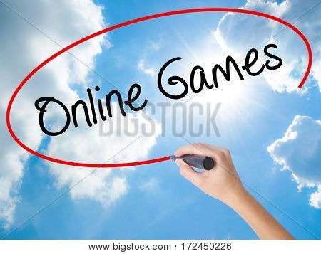 Woman Hand Writing Online Games With Black Marker On Visual Screen