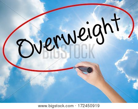 Woman Hand Writing Overweight  With Black Marker On Visual Screen
