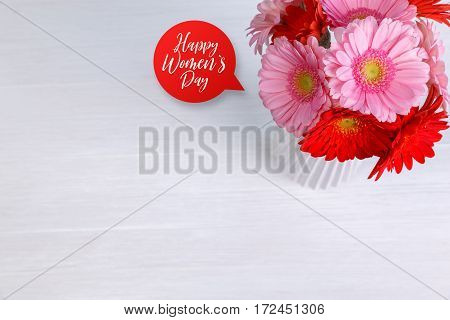 Gerbera flowers in vase on white wood vintage background. 8 march or Valentines day love design. Fresh natural flowers. Happy womens day.