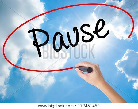 Woman Hand Writing Pause With Black Marker On Visual Screen