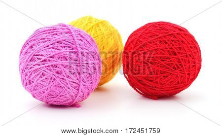 Colorful balls of yarn isolated on white background.