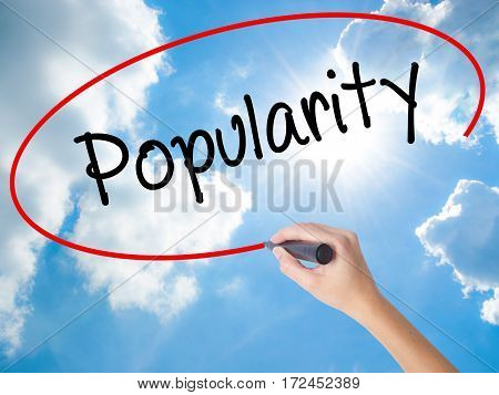 Woman Hand Writing Popularity With Black Marker On Visual Screen.