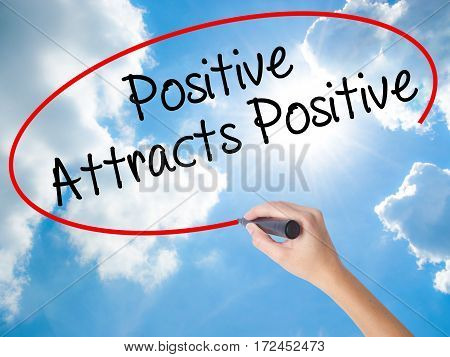 Woman Hand Writing Positive Attracts Positive With Black Marker On Visual Screen