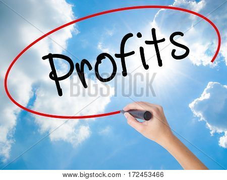 Woman Hand Writing Profits With Black Marker On Visual Screen.