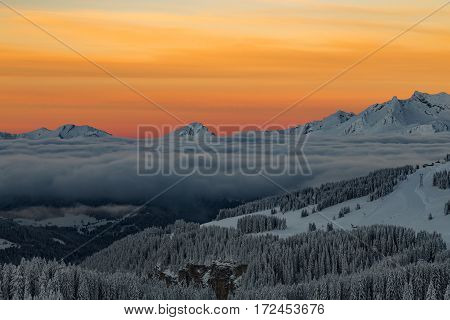 Mountains With A Sunrise Surrounded By Clouds