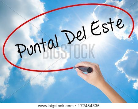 Woman Hand Writing Puntal Del Este With Black Marker On Visual Screen