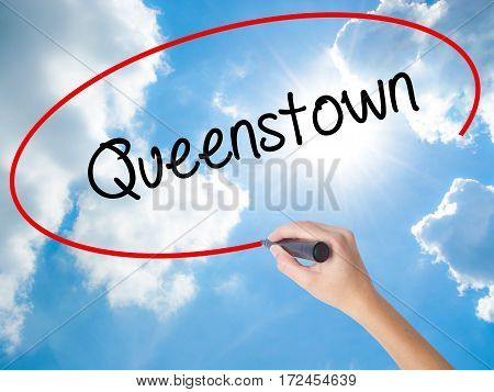 Woman Hand Writing Queenstown  With Black Marker On Visual Screen