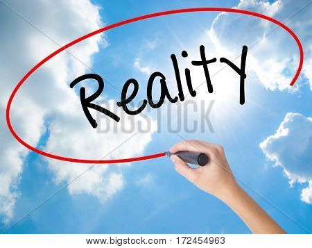 Woman Hand Writing  Reality With Black Marker On Visual Screen