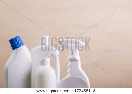 Mock-up plastic bottles. Cleaning products, washing wc cleaner. Mockup design for branding. Front view. Wooden rustic board.