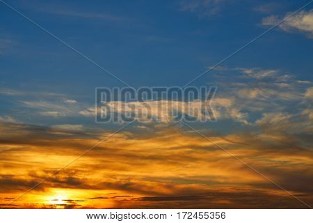 Sunset sky orange clouds over blue background