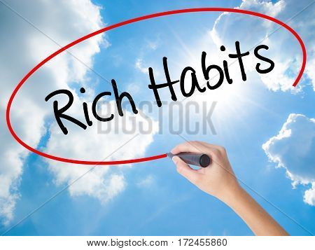 Woman Hand Writing Rich Habits With Black Marker On Visual Screen