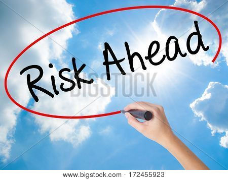 Woman Hand Writing Risk Ahead With Black Marker On Visual Screen