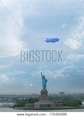 Surrealism. Liberty statue holds zeppelin on a rope.
