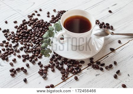 A morning cup of coffee and coffee beans