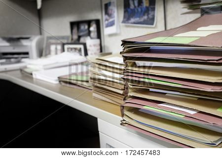 Stack of files on desk at work office location