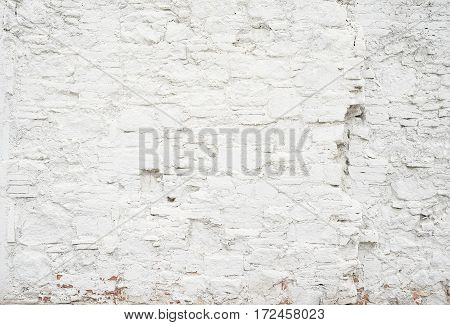 Abstract grungy empty background.Photo of white blank bricks wall texture. Blank cement surface.Horizontal