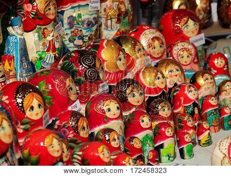 Many red Russian nesting dolls (Matryoshka or babushka) on display at fair