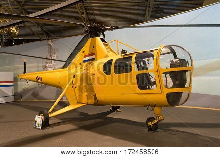 LELYSTAD NETHERLANDS - MAY 15 2016: yellow sikorsky s-55 helicopter in the Aviodrome aerospace museum