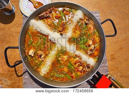 Paella from Spain recipe process ad the rice step by step