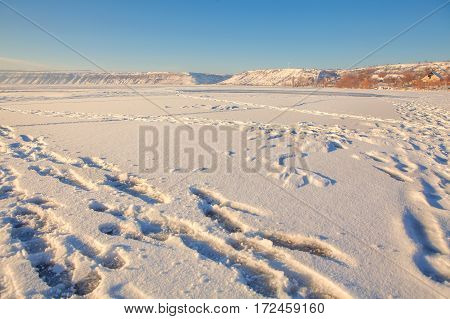 frozen river covered by snow in the winter