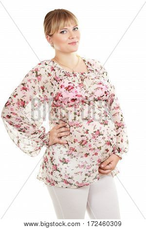 half length portrait of cheerful pregnant woman looking at camera isolated on white background in photostudio