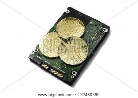 Shiny Gold Bitcoin Coin Laying On Hard Drive
