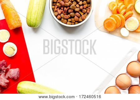 Food for pets with eggs and vegetables on kitchen table backgroun top view mock-up