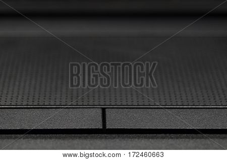 Detail closeup of notebook black touch pad