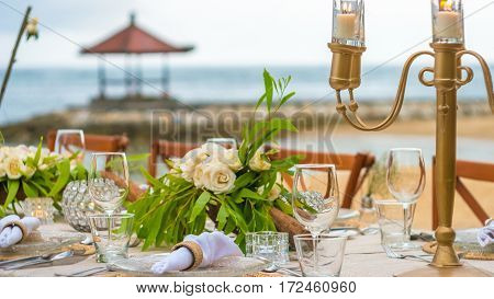Close up of Table becoration in the Restaurant on the Beach. Bali