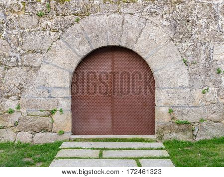 vintage wooden door in a stone wall