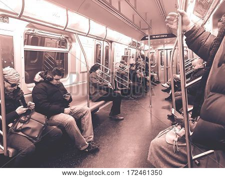 New York Februrary 17 2017: Passengers are riding NYC subway.