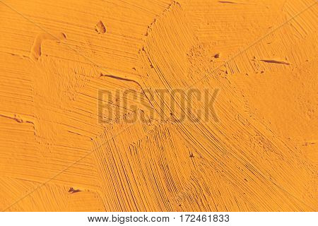 Painting close up of light orange color, paint brush strokes  texture for interesting, creative, imaginative backgrounds. For web and design.