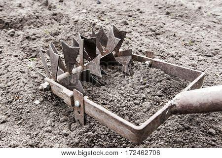manual plow on the ground. horizontal shot
