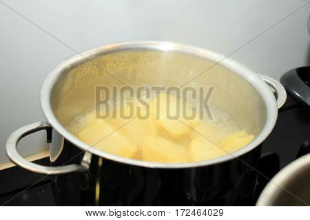 Boiling potatoes in a pan in hot water