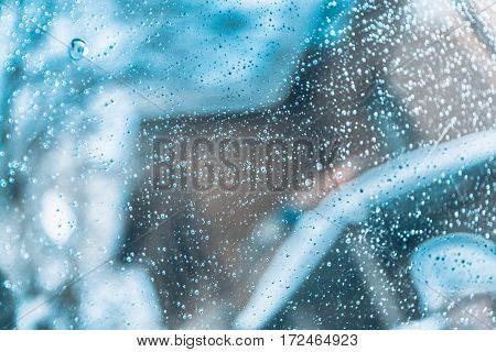 water droplets on glass of car cool tinted