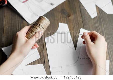 desktop designer clothes with tools at wooden table.