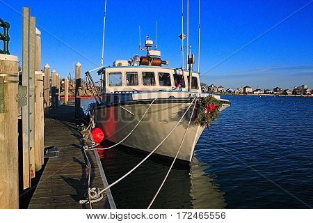 A New England lobster boat is till decorated for Christmas as it waits for spring and the beginning of the fishing season.