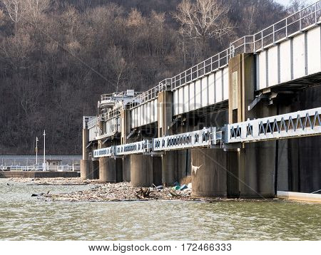 Lock or dam sluice gates on River Monongahela in Morgantown West Virginia with collected trash