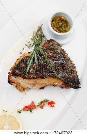 Grilled flounder with lemon and savory sauce