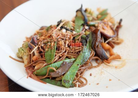 Buckwheat noodles with vegetables and mushrooms, Asian style dish on white plate