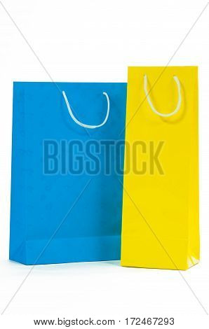 Yellow and blue paper bag isolated on white background