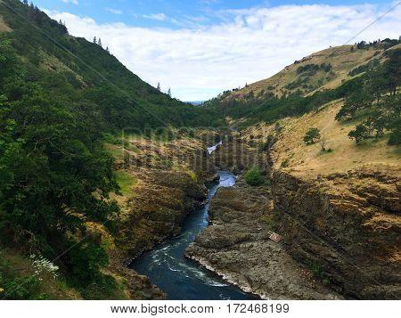 Rushing River Cutting Through Mountain Rocks Creating Canyon