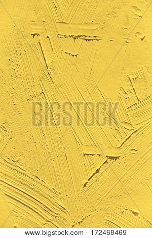 Painting close up of vivid primrose yellow color, paint brush strokes  texture for interesting, creative, imaginative backgrounds. For web and design.