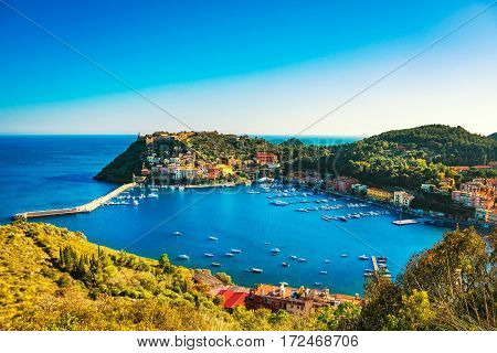 Porto Ercole village and boats in harbor in a sea bay. Aerial view. Monte Argentario Maremma Grosseto Tuscany Italy
